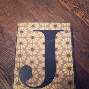 J initial on wooden wall hanging art piece